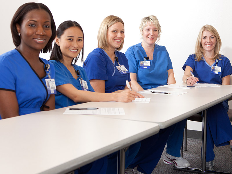 Diverse Nurses Sitting at a Table